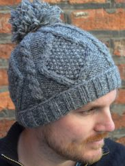 Half fleece lined hand knit celtic bobble hat Grey